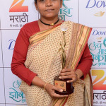 Anuradha receives award on TV