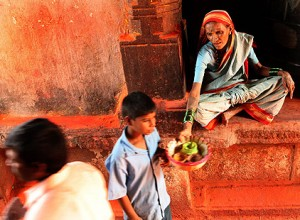 Older Devadasi woman begging outside a temple dedicated to Yellama. Photo courtesy of Julia Cumes